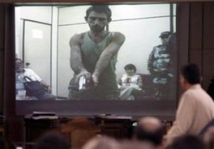 Rayfran das Neves Sales, is seen in a video which shows how he killed nun Dorothy Stang during a trial at Justice Tribunal in Belem, Brazil, on Friday, Dec 9, 2005.