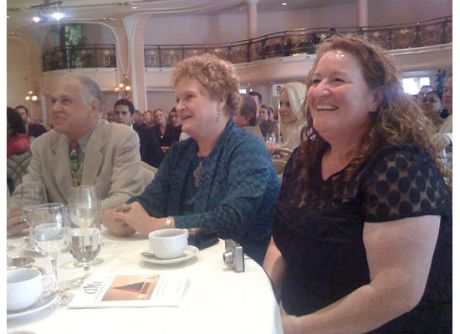 Tom Norris, Marianne Muellerleile, and actress Rusty Schwimmer enjoy Mark Derwin's comedic commentary
