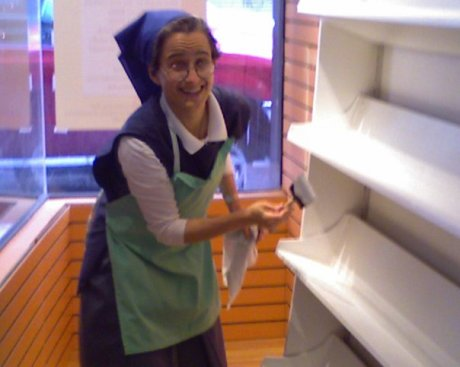 Sr Carmen Christi, newly back from a year-long course in Pauline studies in Rome (and the new novice director for our province of the Daughters of St. Paul) lends a hand at prepping the fixtures. When you enter the convent there is always some light outdoor - or indoor work - involved!